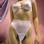 Mannequin in a slash of mesh with Lady Bush