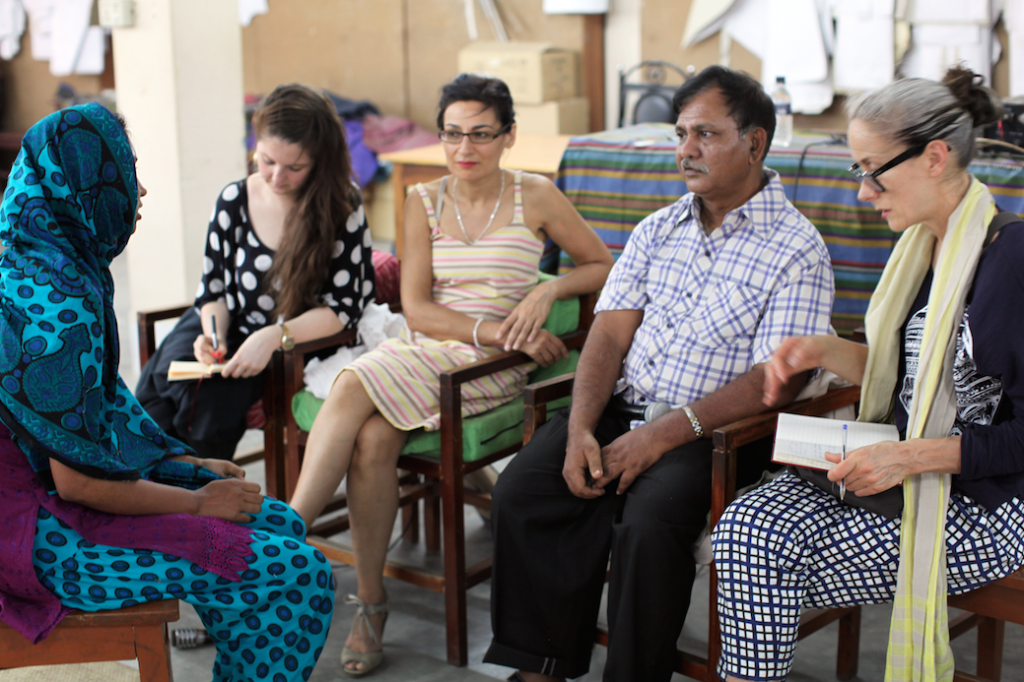 Caryn and Safia listening to workers talk about conditions in Dhaka factories